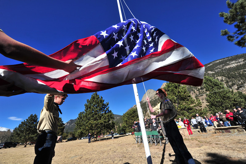 The local Boy Scout troop raises the flag over Monday's Veterans Day Service The troop is sponsored by the American Legion Post 119.