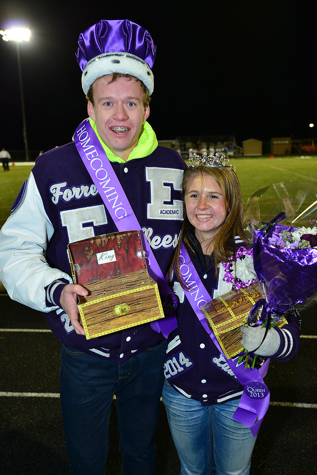 Forrest Beesely and Laural Todd anjoy their moments of fame at halftime of the Estes Park Homecoming game on Friday. The pair were elected Homecoming King and Queen for 2013.