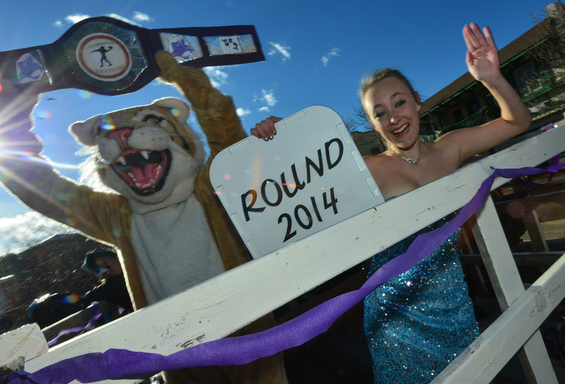 Seniors and the Bobcats' mascot roll down Elkhorn Avenue on Friday. The seniors' float had a prize fight theme for this year's Homecoming parade.