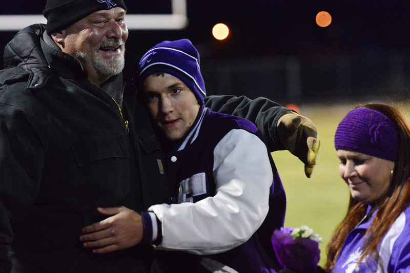 Senior Keith Trahan gets hugs from his family before Friday's Homecoming game. The game was also senior night.