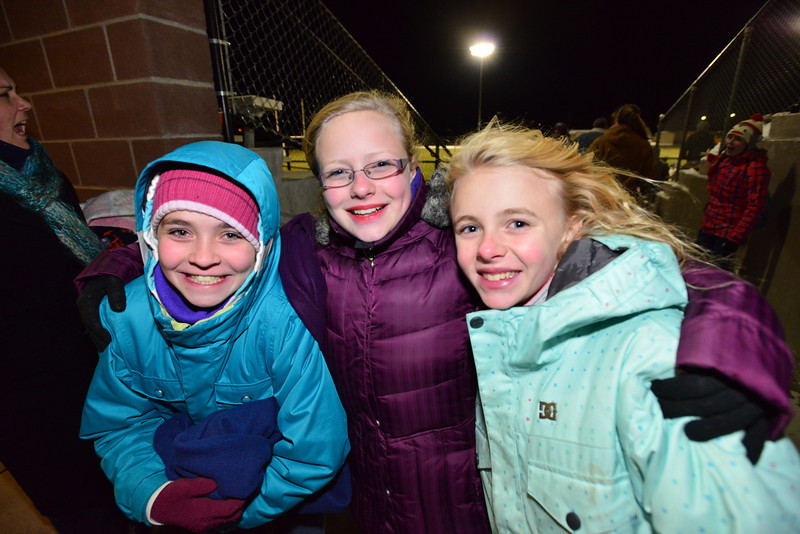 Middle school students bundled against Friday's breeses attend the Homecoming game.