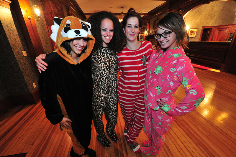 Sometimes, sleepware is the best outfit. Revelers appear at the Stanley Hotel in footie pajamas.