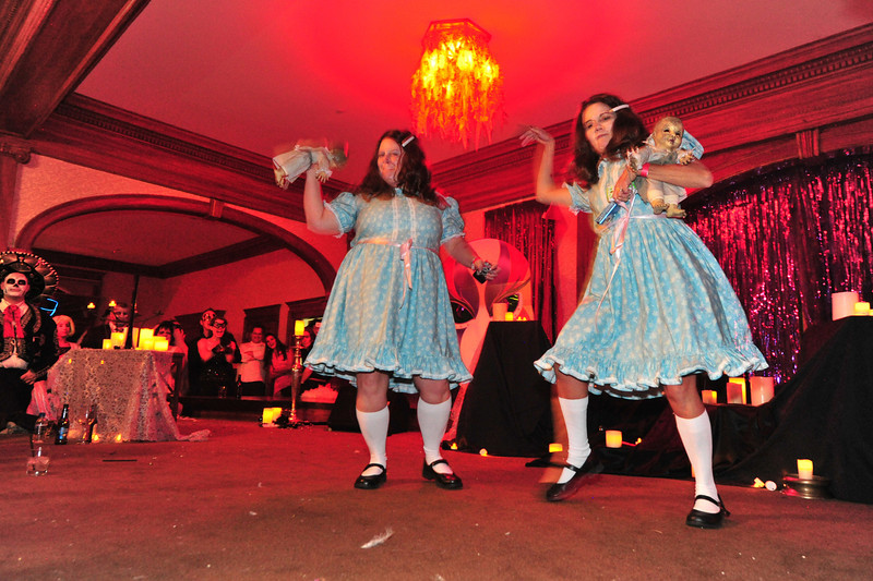 The infamous Shining twins dance for the crowd on Saturday. The pair had already won creepiest costume honors.