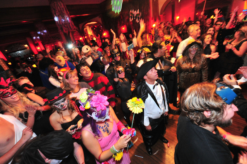 Revelers at the Shining Masquerade Ball undulge their alter-egos on the Stanley Hotel ball room floor on Saturday. The annual event draws costumed party-goers from the Front Range, Texas and as far away as California.