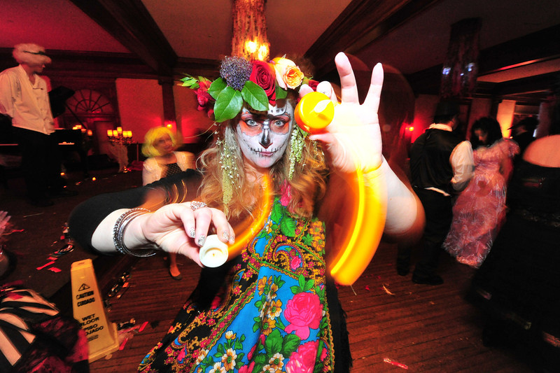 Roxann Rowley of Estes Park has fun with the electric candles at the Shining Ball.