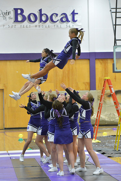 Cheerleaders fly during last year's pep rally. There is usually a pep rally at the high school on Friday afternoon before the parade and the game.