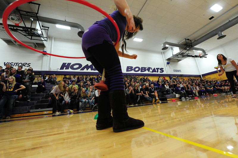Maya Michener tries the hula hoop while holding a plunger during last year's pep rally. The event features entertaining competition between the classes.