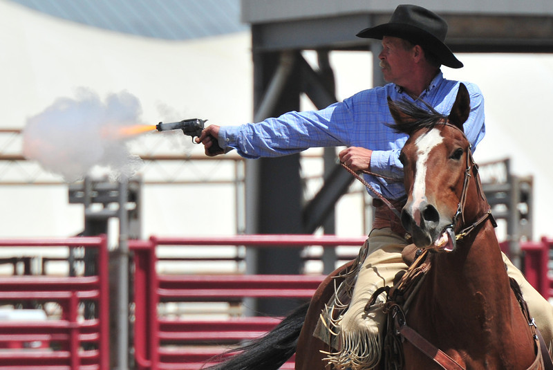 A competitor in this weekend's Cowboy Mounted Shooting event fires on a target while on the run on Saturday. The event featured cowboys from all over the Front Range.