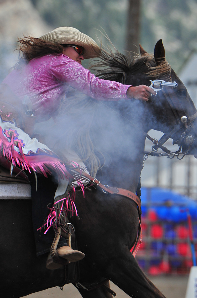 Cowgirl Jennifer Lauppe of Fowler, Kans., lines up a shot on Saturday. Both men and women participated in the event requiring both a good aim and good horsemanship.