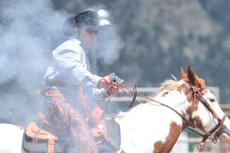 Smoke clears after a cowboy shoots on Saturday.