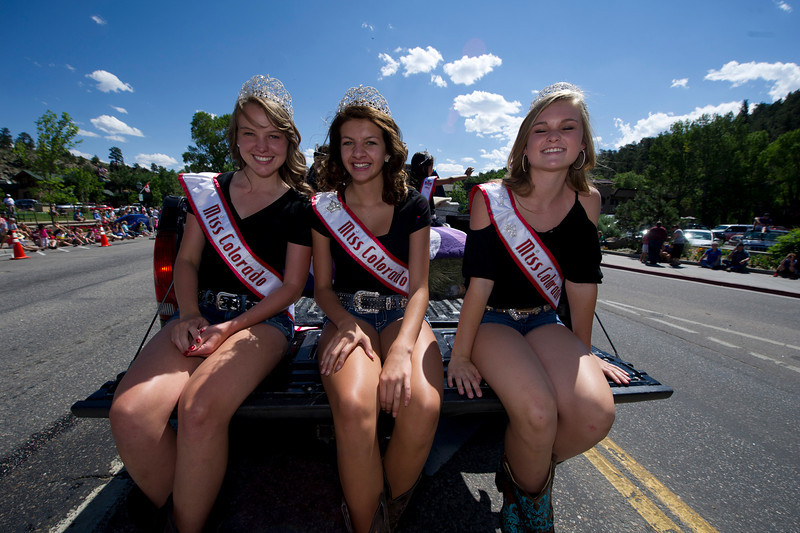 Young pageant winners enjoy the ride through town on Tuesday.