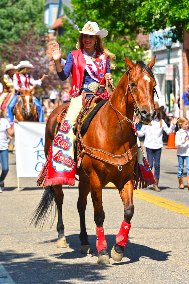Miss Rodeo America, Chenae Shiner of Roosevelt, Utah, waves to parade fans on Elkhorn Avenue on Tuesday. Shiner is a smart cookie, persuing a BS in Radiologic Sciences with an emphasis in Magnetic Resonance Imaging and Computed Tomography.