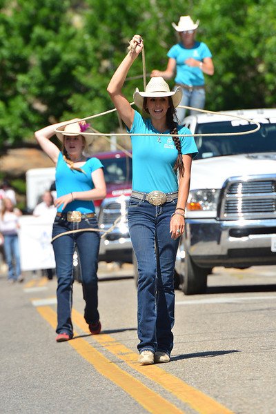 The young ladies of the Riata Ranch Cowboy Girls perform on their way through downtown Estes Park on Tuesday. The group promotes hard work, discipline, respect and pride through horsemanship and Western values.