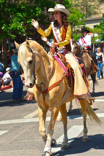 Michelle Claypool smiles and waves as she rides down Elkhorn Avenue during the Rooftop Rodeo Parade on Tuesday morning. The parade is the start of the 87th Rooftop Rodeo running through Sunday night with performances starting at 7 p.m.