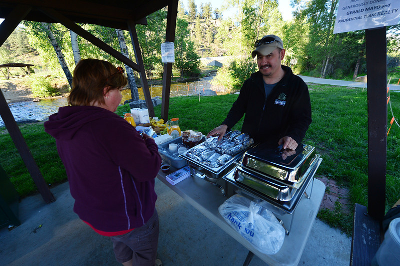 Breakfast steams at the Bike to Work breakfast station on Wednesday. The breakfast burritos were donated by Gerold Mayo.