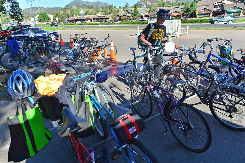 Kristin Rauch racks her bike at the Estes Park Visitor Center on Wednesday. Many of Estes Park's commutors made the trip by bike and passed through the Bike to Work Breakfast Station.