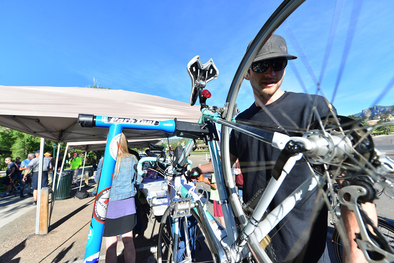 A bike mechanic spins through gears on a bike at the breakfast station on Wednesday. The Estes PArk Mountain Shop mechanics helped repair bike problems, donating their services.