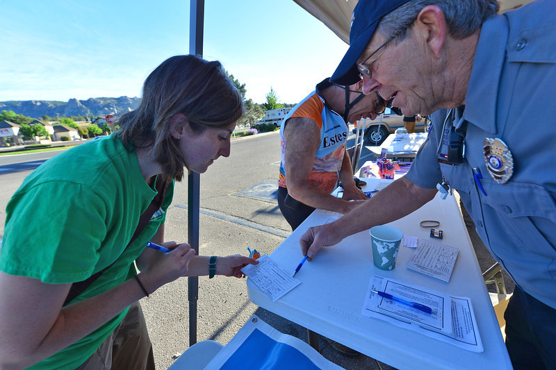 A rider gets help with a registration form at the Bike to Work Breakfast Station on Wednesday. Registering a bike make the bike easier to track down if it is lost or stolen.