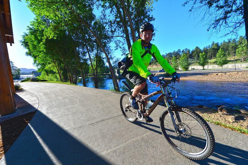 The national park's Danny Basch wheels past the Estes Park Visitor Center on his way to the Bike to Work Day Breakfast Station on Wednesday. The event promoted building fitness and fun into a morning commute in Estes Park and throughout Colorado.