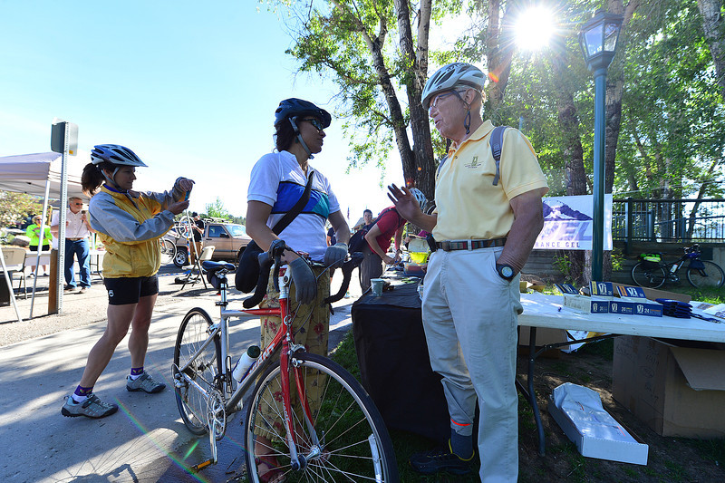 Mayor Bill Pinkham, in yellow, talk to Estes Valley Library Director Claudine Perrault at the Breakfast Stop for the Ride to Work Day.Many of the town's officials and employees rolled through the station in support of the town's first Ride to Work Day.