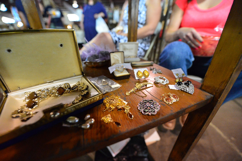 Antique jewelry shimmers in the barn's light on Saturday. The Western Heritage Antique Show had items for all tastes.