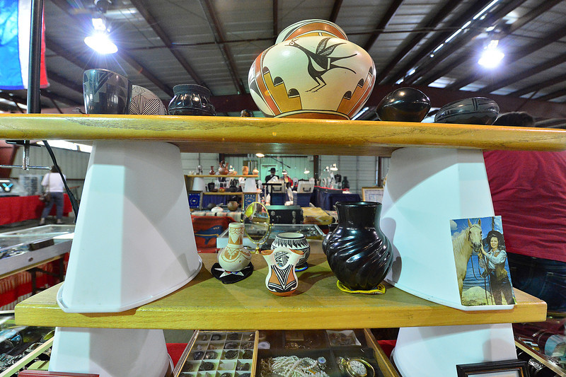 Native American pottery adorn a table at the Western Heritage Antique Show on Saturday. Native American pottery's distinct look comes from techniques that have not changed for centuries.