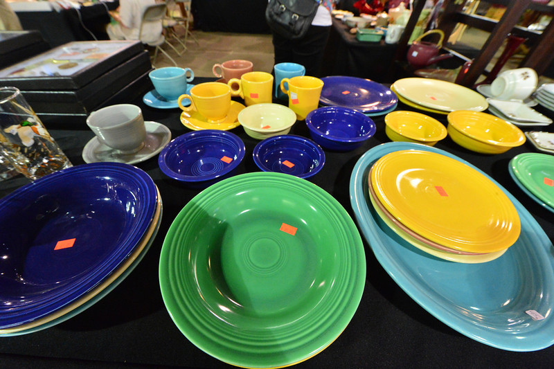 A table of the famous FiestaWare  satat the Western Heritage Antique Show on Saturday. The vintage mid-20th Century plates are a favorite of collectors.
