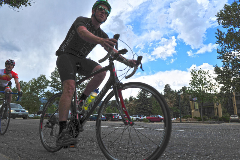 A pair of cyclists rolls through Estes Park on Wednesday. The town has become a more attractive destination for Front Range cyclists, with our altitude, challenging climbs and scenery.