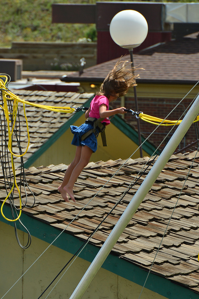 A child flys above the rooftops along Moraine Avenue on Wednesday.