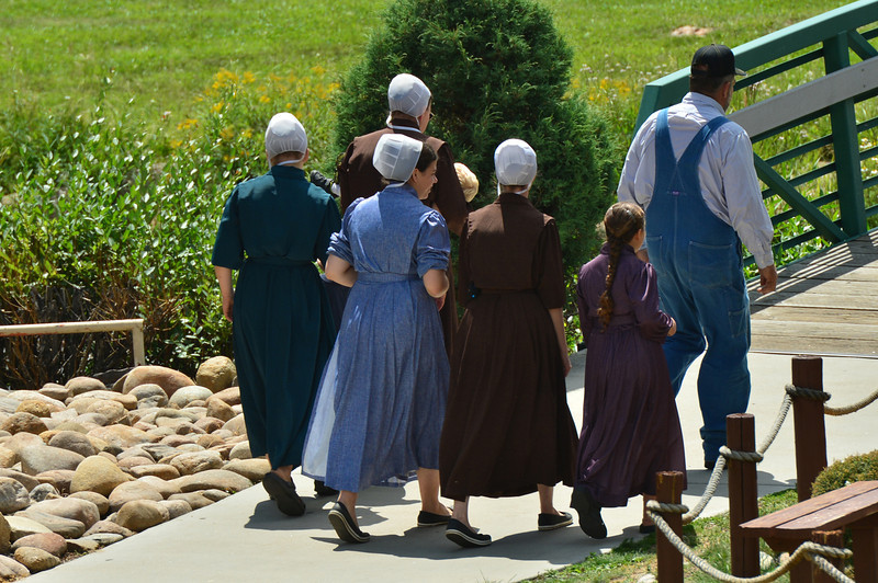 A Mennonite family stroles between attractions and rides at one of Estes Parks small amusment parks on Wednesday. The humble and conservitive Christian sect members are not out of the ordinary during the summer in Estes Park.