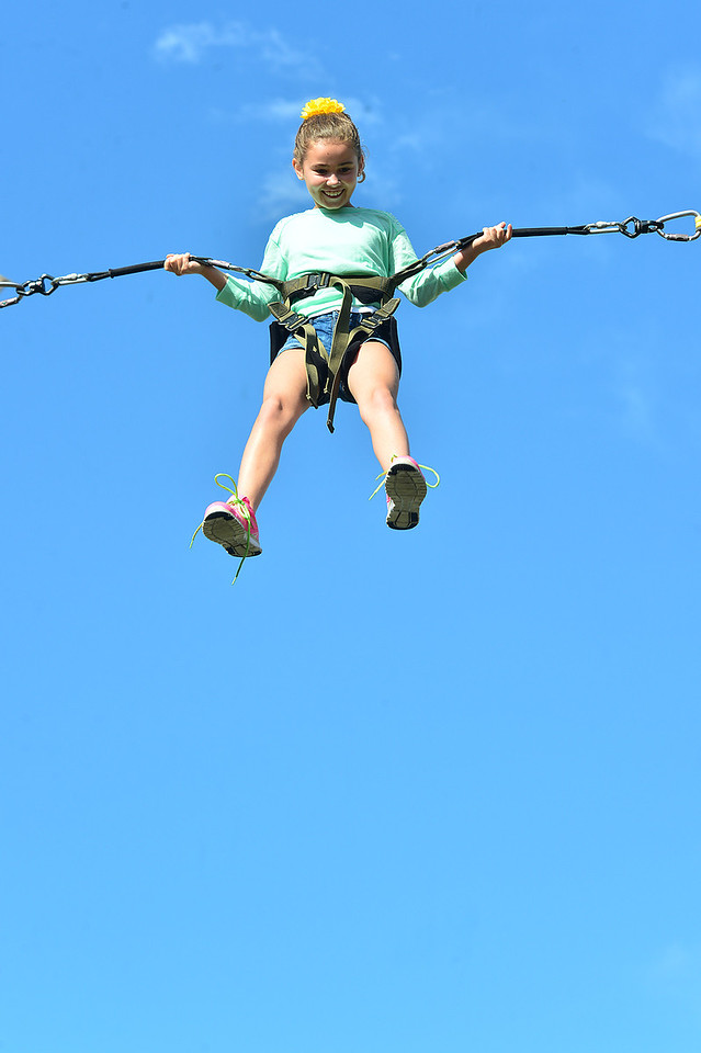 Noelle Stover, 10, of Dallas, Texas, enjoys a flight into the blue above Estes Park on Wednesday. While the summer is nearing its end, there are still plenty of opportunities for fun in Estes Park.