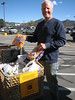 Charley Dickey unloads a shopping cart of donated candy from Safeway patrons.