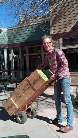 Rob Pieper, owner of Poppys Pizza & Grill, hauls four cases of Skittles donated by McLane.