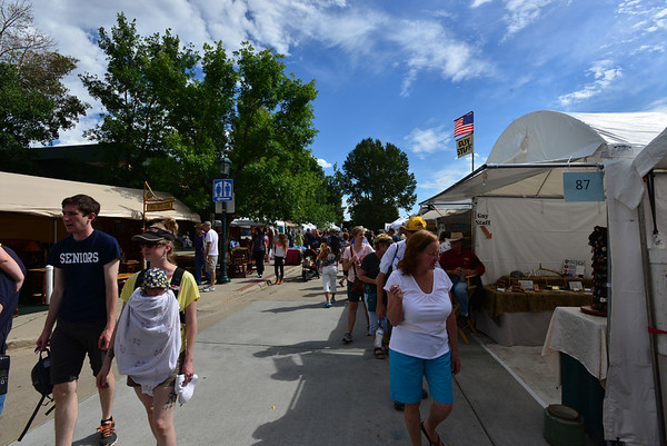 Some of the visitors to the annual Estes Park Labor Day weekend art and craft sale held in Bond Park.