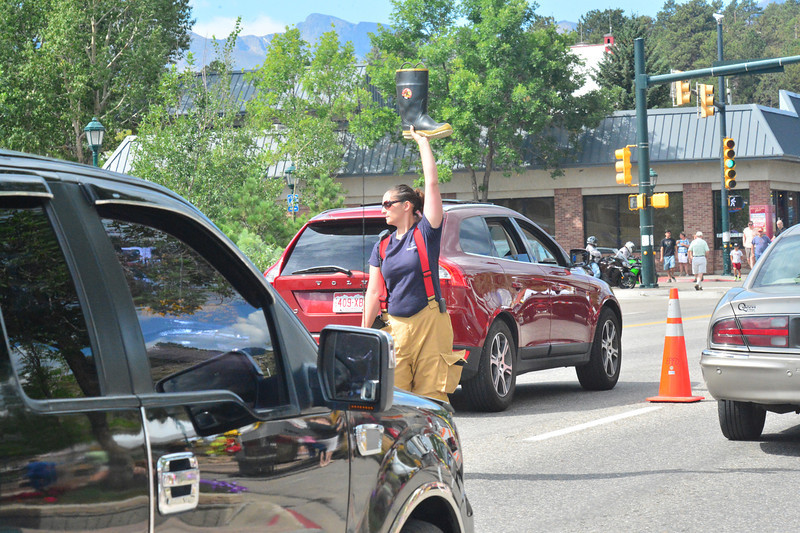 "Estes Park volunteer firefighters collected money for the Muscular Dystrophy Association over the Labor Day weekend with the annual ""Fill the Boot"" campaign. They collected funds from motorists on Elkhorn Avenue."