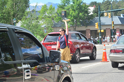 """Estes Park volunteer firefighters collected money for the Muscular Dystrophy Association over the Labor Day weekend with the annual """"Fill the Boot"""" campaign. They collected funds from motorists on Elkhorn Avenue."""