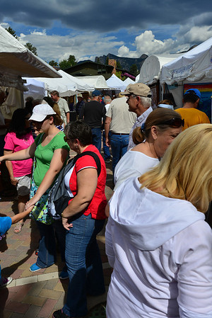 Crowds milled through the opening of the annual Labor Day arts and craft fair in Bond Park in downtown Estes Park on Saturday, Aug. 31. The annual event continues through the Labor Day holiday.