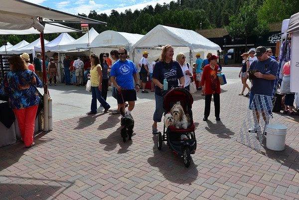 Sometimes you just need a ride. A pair of pooches enjoy a ride in a stroller Saturday during the annual Estes Park Labor Day weekend art and craft sale held in Bond Park.