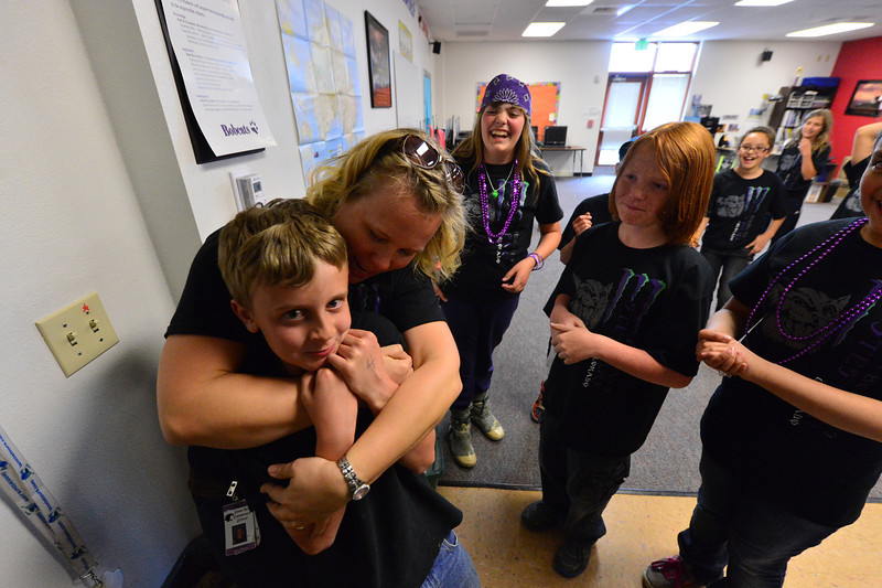 Fifth-grade teacher Erin Pitsch hugs students on the last day of classes for the year.