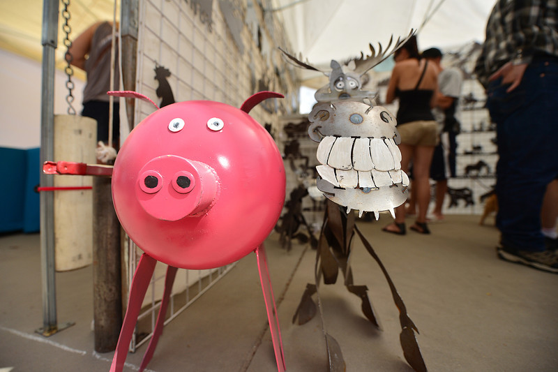 A metal pig and smily moose decorate Bond Park on Saturday.