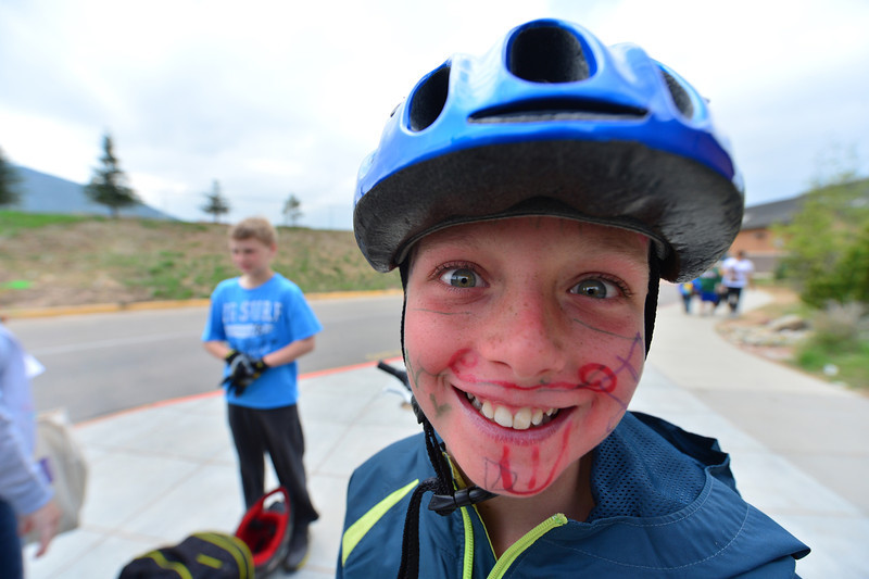 A student shows off artwork . . . on his face on the last day of classes for R3 schools for the year.