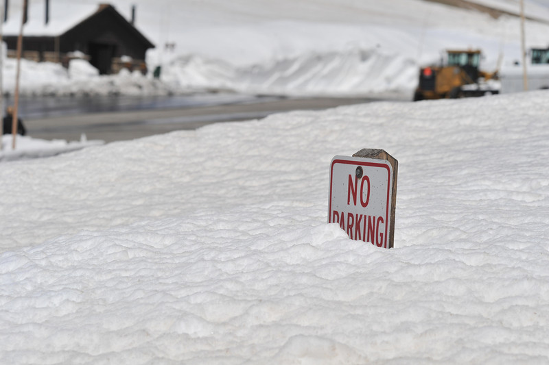 A sign is burried in snow at the Alpine Visitor Center on Friday.