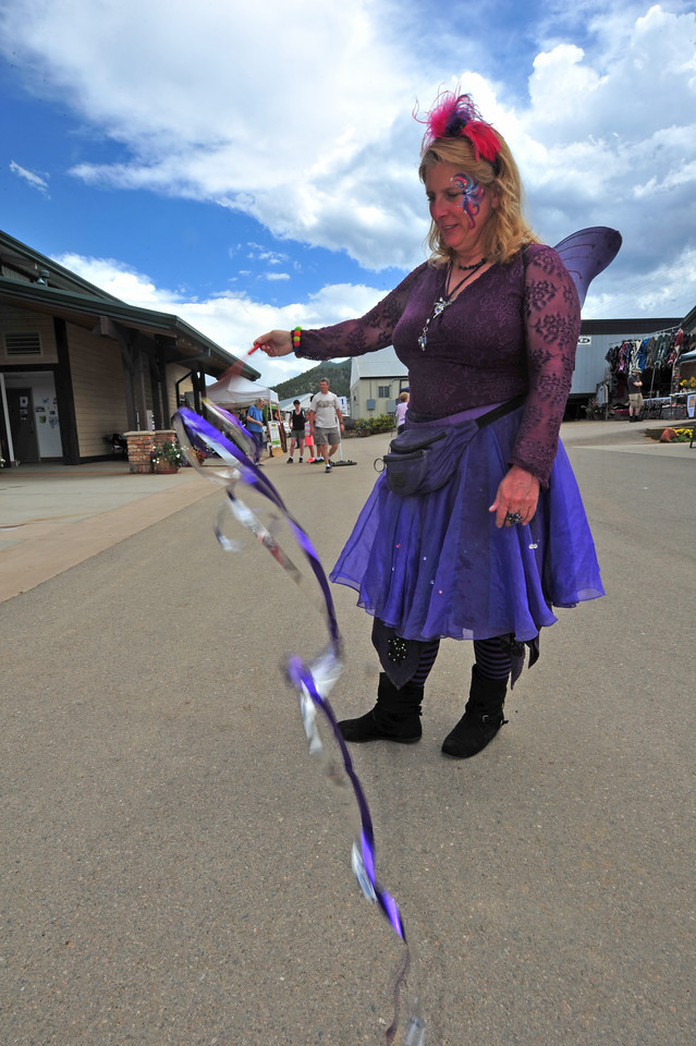 Kelleen Raska of All About Fairies entertains vsitors to the Heritage Festival on Saturday.