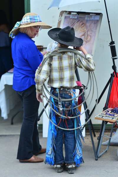 A young cowboy admires a drawing at the Heritage Festival on Saturday.