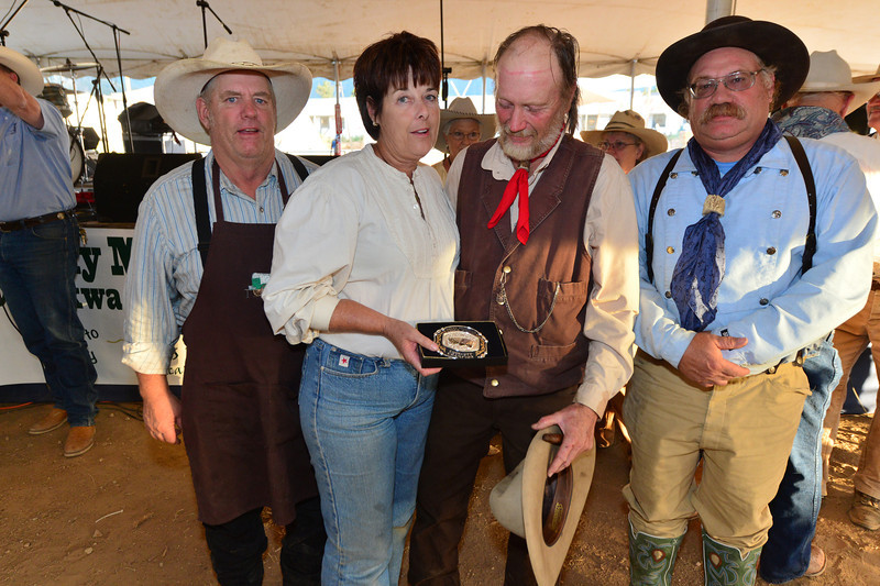 The Lizzie II chuck wagon crew celebrate their first overall at the Heritage Festival on Saturday. A chuk wagon cookoff was added to the activities at the festival this year.