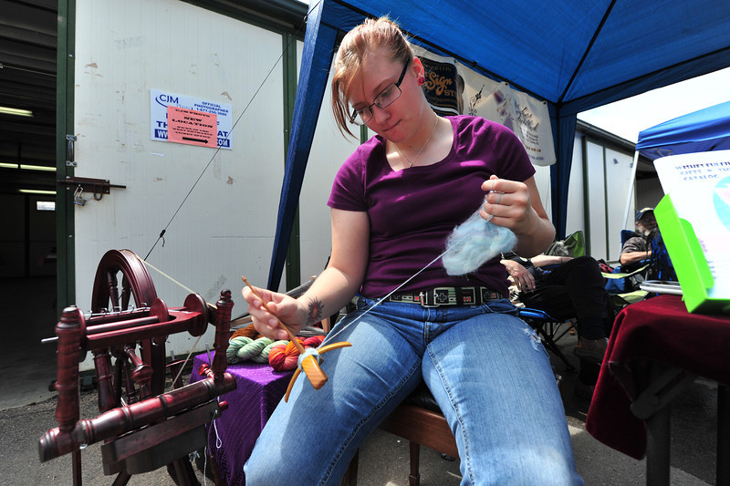 Kaesi Babbett twists yarn to creat fibers at the heritage festival. The activity was very commen 150 years ago, when Colorado was a territory.