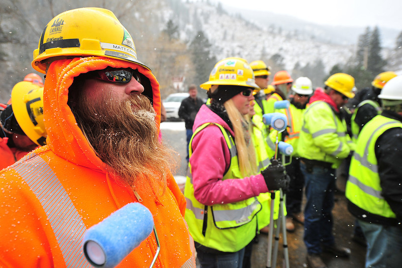 Matt Campbell of Kiewit Construction collects snow while his breath freezes his beard in Drake on Thursday. Kiewit and several other agencies and companies worked around the clock to re-open the Big Thompson Canyon after September's historic flood.