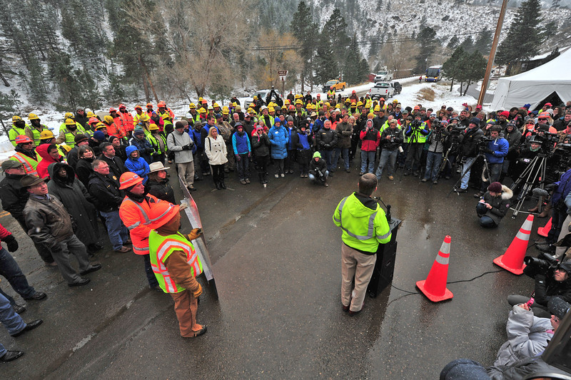 Colorado Governor John Hickenlooper addresses the assembled crowd at the Drake Fire Station during Thursday's re-opening ceremony for US Hwy 34. Construction workers, dignitaries and residents all attended the event.