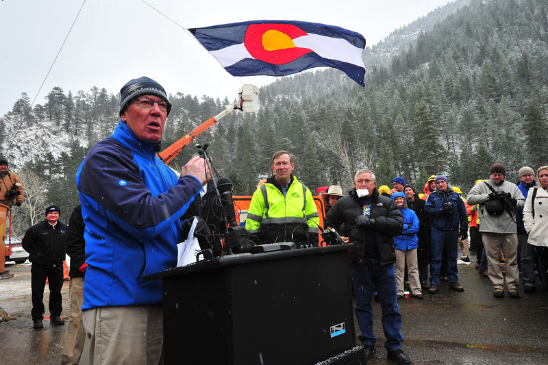 Estes Park Mayor Bill Pinkham addresses the ceremony in Drake on Thursday. Officials from Estes Park traveled to Drake for the official re-opening ceremony for US Hwy 34.