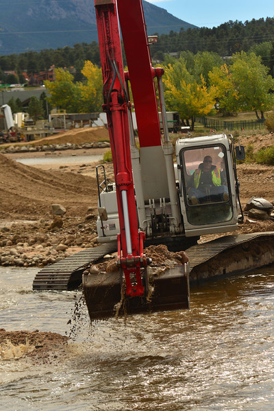 Heavy equipment pulls materiel out of Lake Estes near the Fishman's Nook on Monday. The gravel will be used to repair raods around Estes Park.